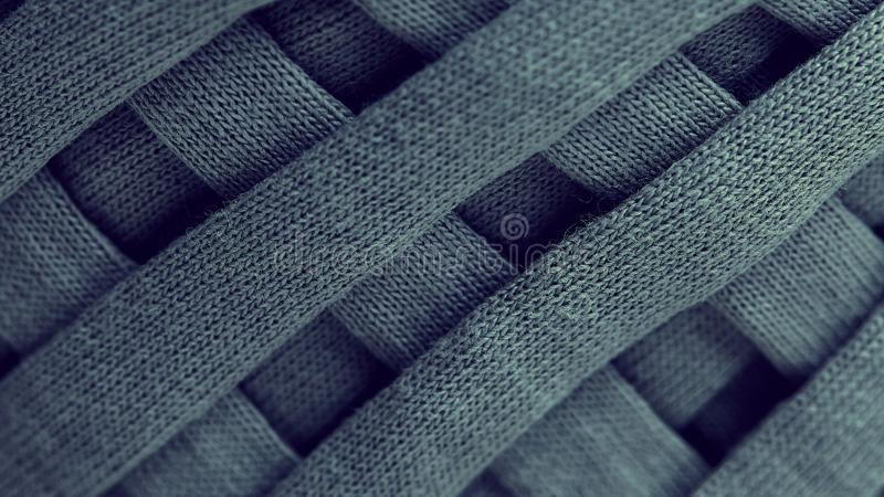 Skein of gray knitted yarn close-up. macro photography background texture pattern weave fiber textile fabric. strips of fabric are royalty free stock photography