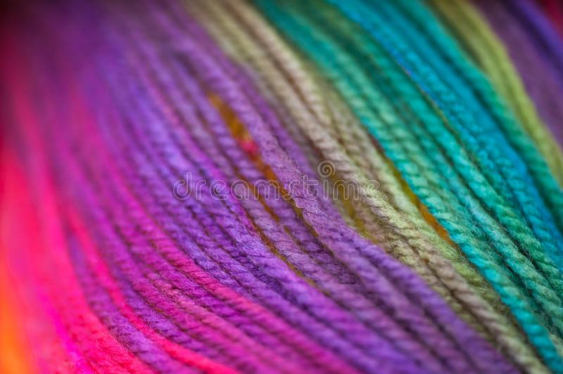 Skein of vid rainbow colored acrylic threins in free placement background zdjęcia royalty free