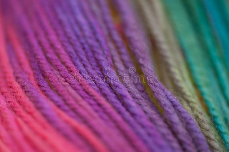Skein of vid rainbow colored acrylic threins in free placement background obraz royalty free