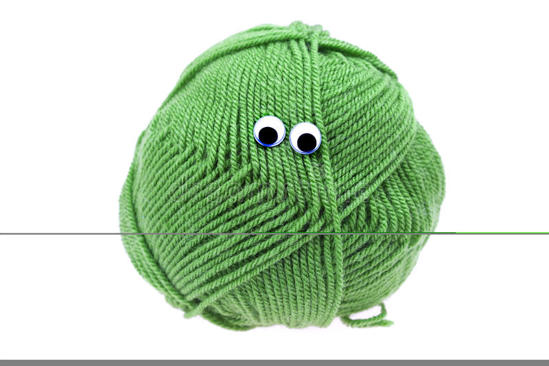 Skein of wool with eyes royalty free stock images