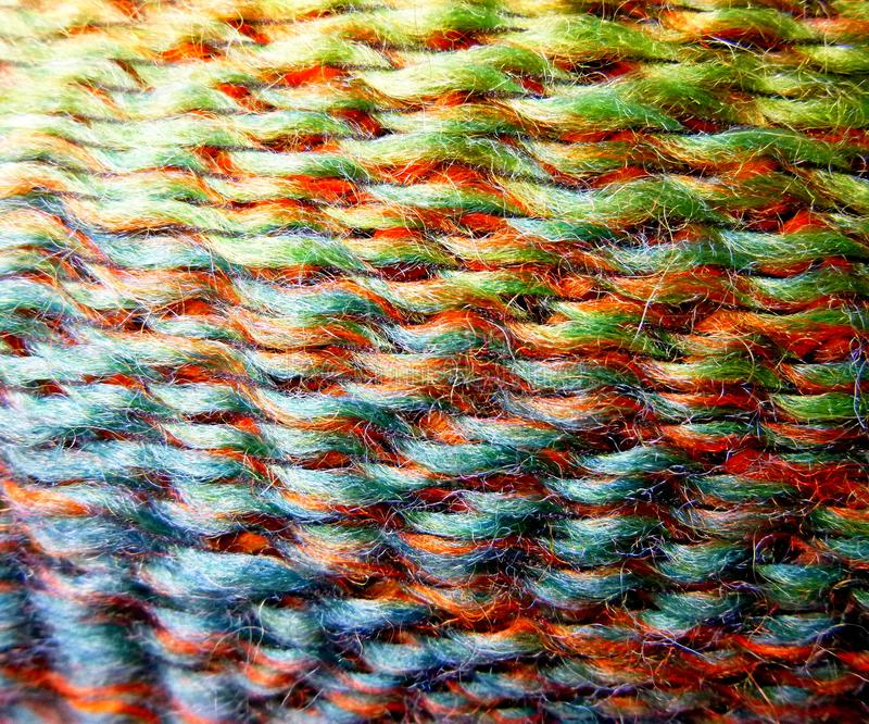 Skein of wool yarn. Macro shooting. Texture of wavy thread. Bright rainbow multicolor threads. Background image. Hobbies leisure stock photography