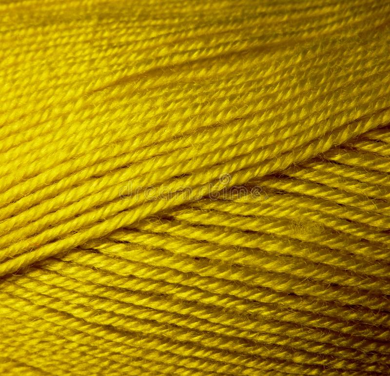 Skein of wool yarn. Macro shooting. Texture of wavy thread. Yellow green threads. Background image. Hobbies leisure crafts stock image