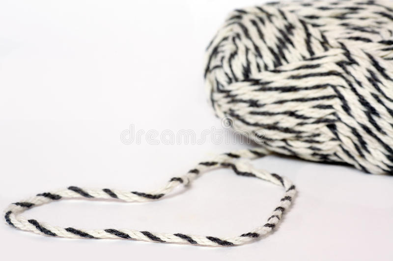 Skein of yarn melange closeup and heart shape. From thread royalty free stock photo