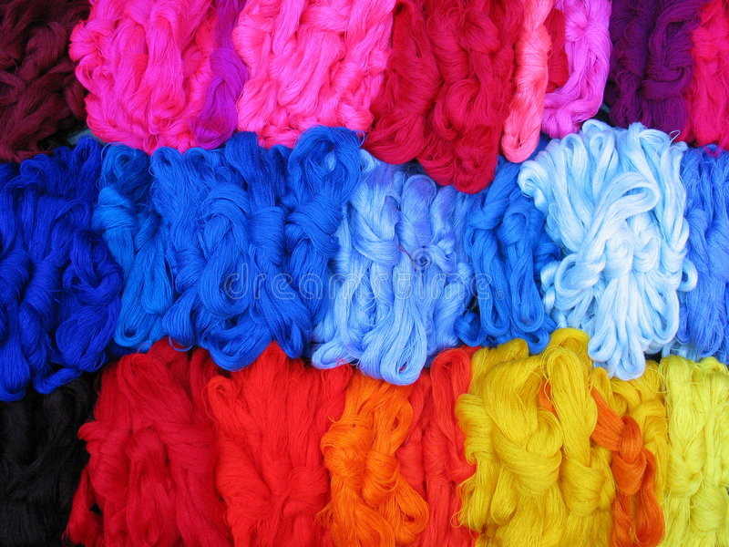 Skeins of colourful threads royalty free stock photo