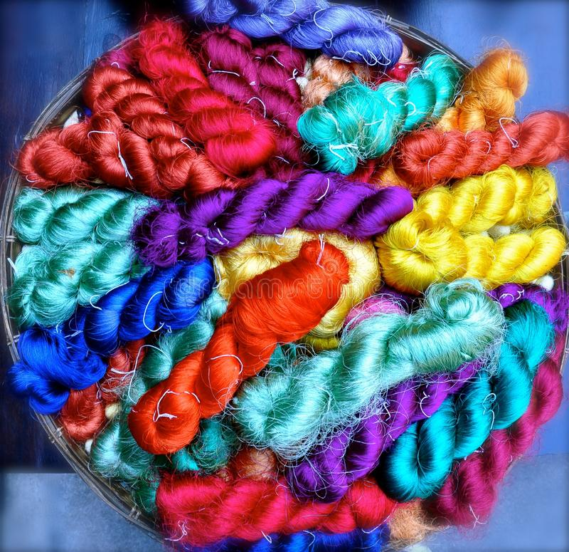 Skeins of dyed silk royalty free stock photos
