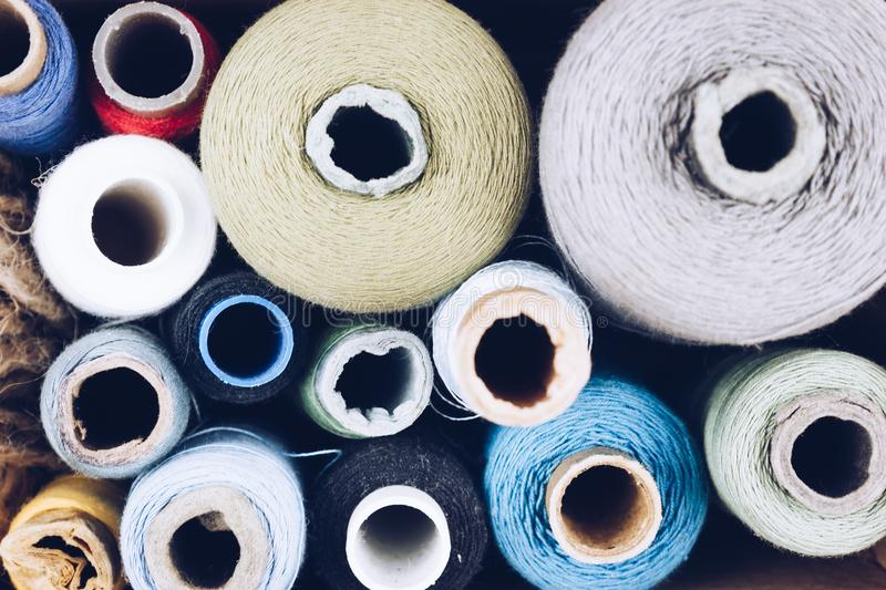 Skeins of thread for sewing the background. Crafts, tailor stock images