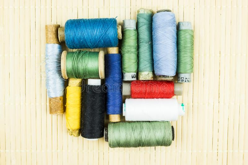 Skeins of thread for sewing the background. Crafts, tailor royalty free stock photos