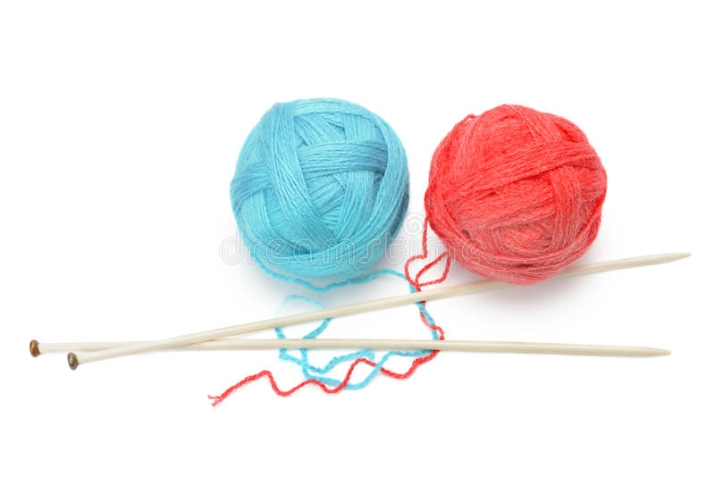 Skeins of yarn and knitting needles stock images
