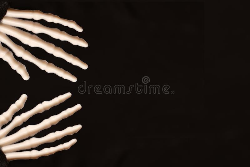 Skeletal hands on black background with copy space, death and mistery concept, halloween.  stock photos