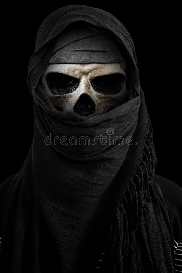 Skeleton in black veil with dark environment. On black background royalty free stock photography