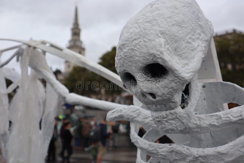 Skeleton at the Extinction Rebellion protest. stock photo