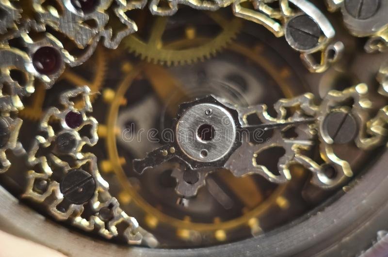 Skeleton hours. Antique antique clockwork, jewelry engraving. mechanical pocket watch close-up, selective focus. Mechanism with gears. clockwork skeleton royalty free stock images