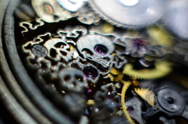Skeleton hours. Antique antique clockwork, jewelry engraving. mechanical pocket watch close-up, selective focus. Mechanism with gears. clockwork skeleton royalty free stock image