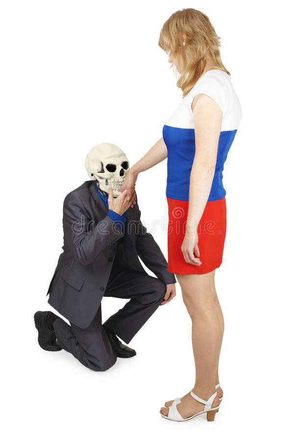 Skeleton Kisses Hand To Young Woman Royalty Free Stock Photo