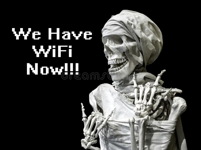 Skeleton model of the man with the inscription we have wifi now. The concept of after death. afterlife of the future. The skeleton model of the man with the royalty free stock photos
