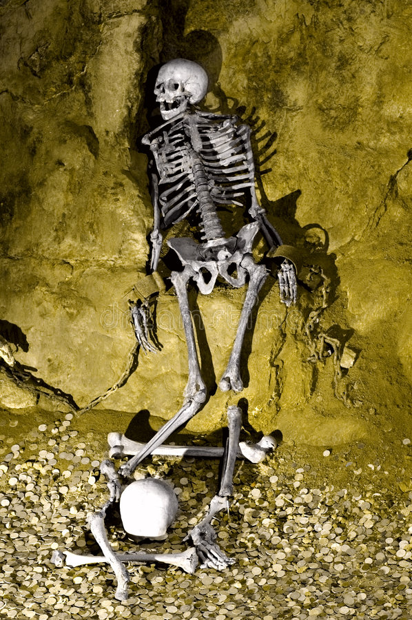 Skeleton prisoned in cave royalty free stock photo