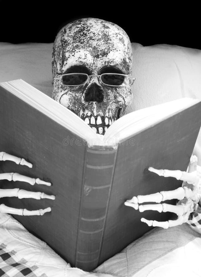Skeleton reading stock images