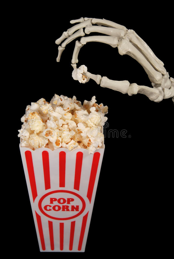 Skelett mit Popcorn stockfotos