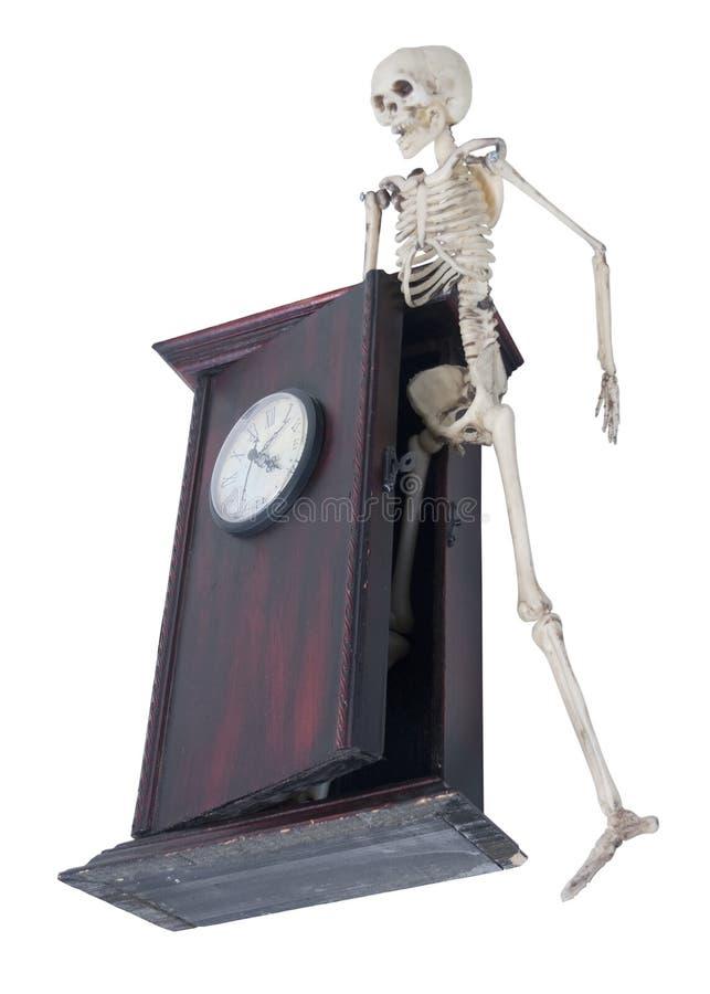 Skelett tauchen von der Uhr der Zeit auf stockbilder