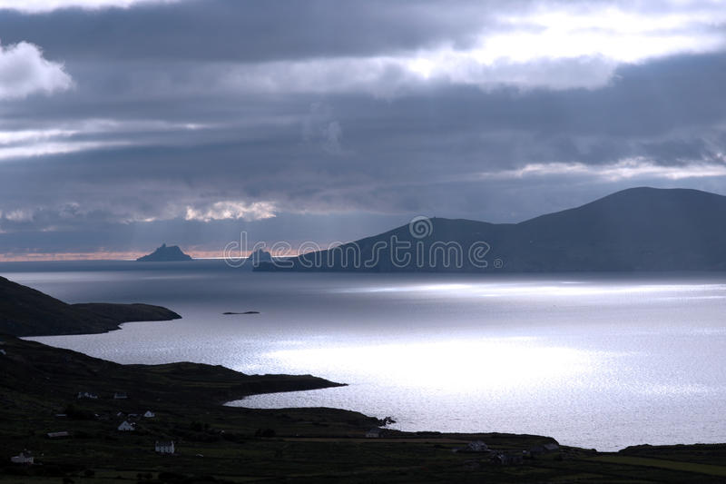 Skellig rocks view. Kerry scenic view of the Skellig rocks in ireland with mountains against a beautiful blue cloudy sky royalty free stock images