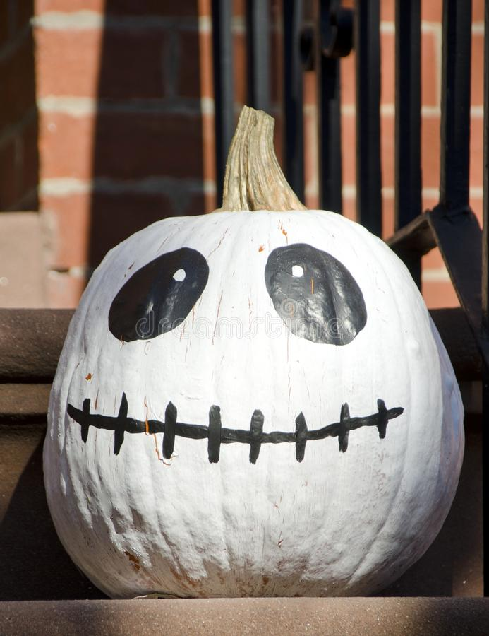 Skellington Pumpkin. A white pumpkin with the face of Jack Skellington the skeleton character for Halloween royalty free stock image