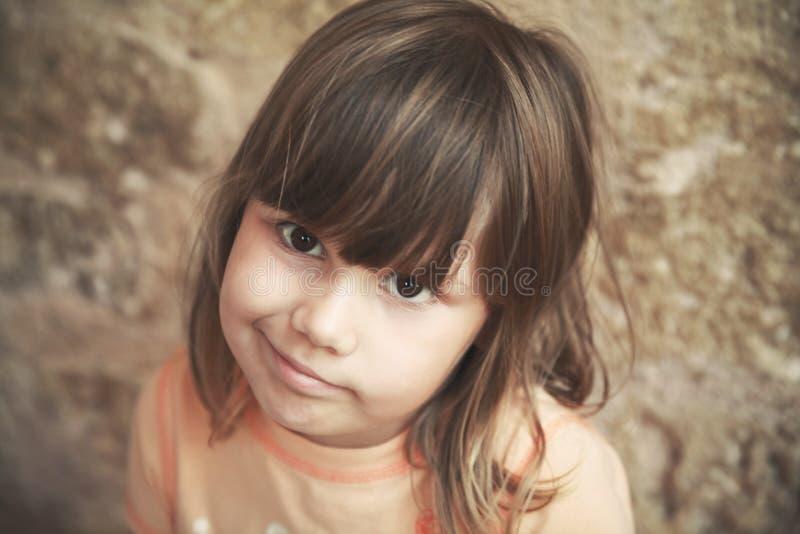 Skeptical Caucasian little girl, close up stock photos