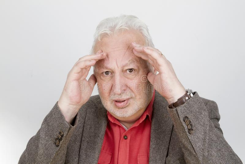 Skeptical senior male royalty free stock image