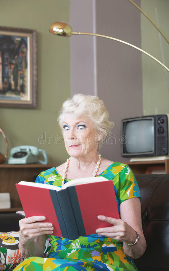Skeptical Woman with Book stock photo