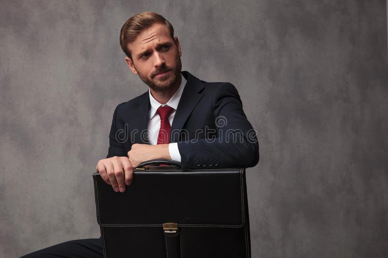 Skeptical young business man waits for an interview stock images