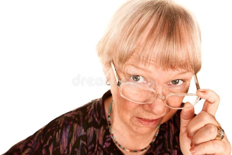 Skeptische ältere Frau stockbilder