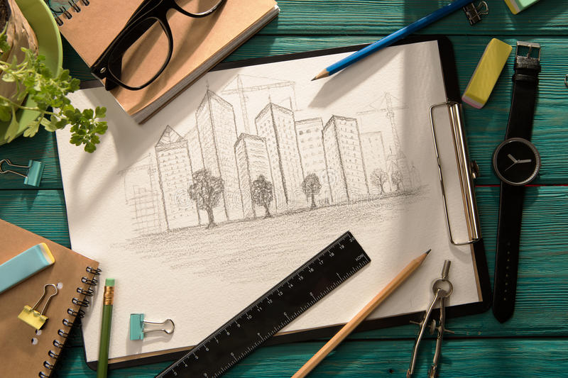 Sketch of architecture on the desk. Real estate concept - sketch of architecture on the desk stock images