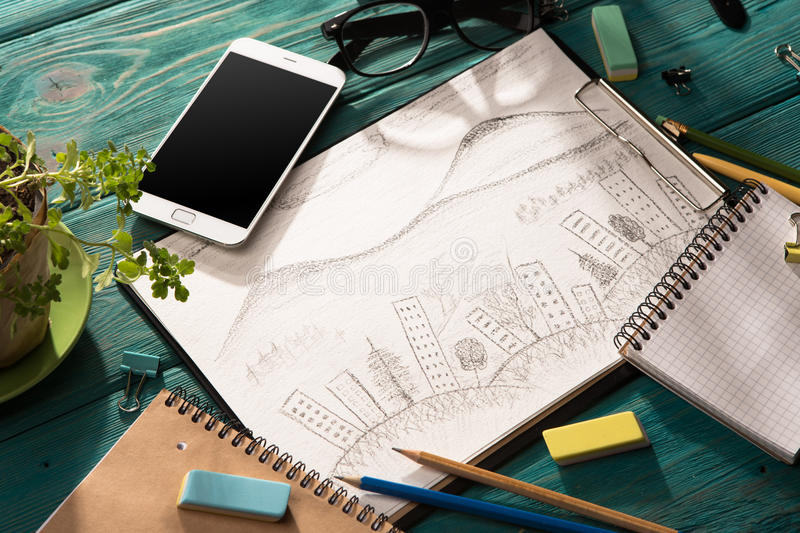 Sketch of architecture on the desk. Real estate concept - sketch of architecture on the desk royalty free stock images