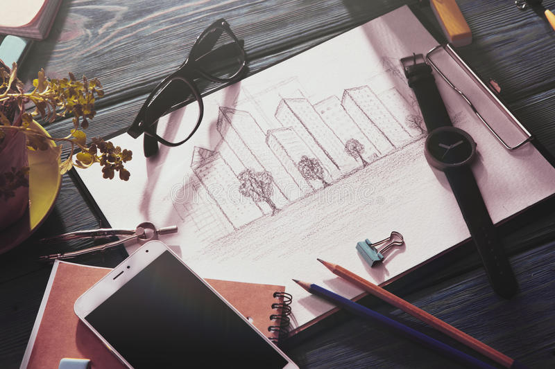 Sketch of architecture on the desk. Real estate concept - sketch of architecture on the desk stock photo