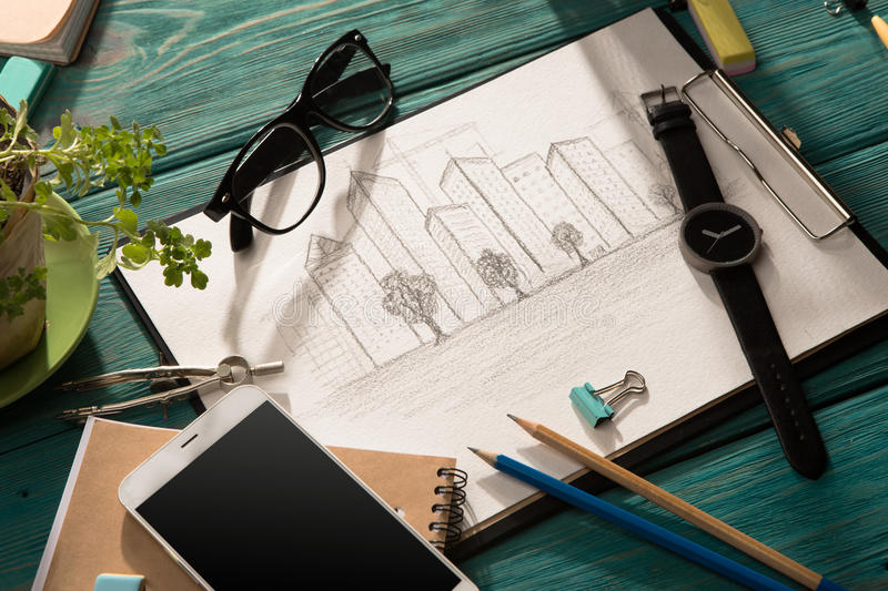 Sketch of architecture on the desk. Real estate concept - sketch of architecture on the desk stock photos