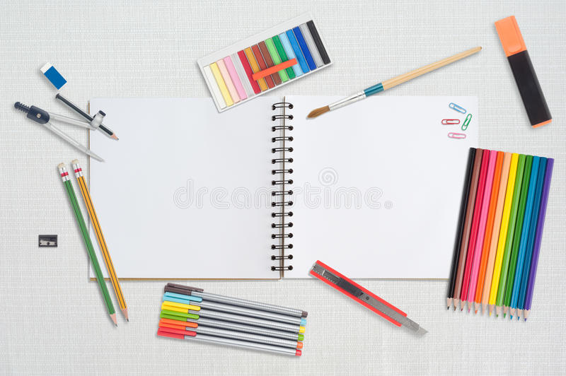 Sketch book and paint tools on table cloth for back to shcool. Sketch book and paint tools on table cloth stock images
