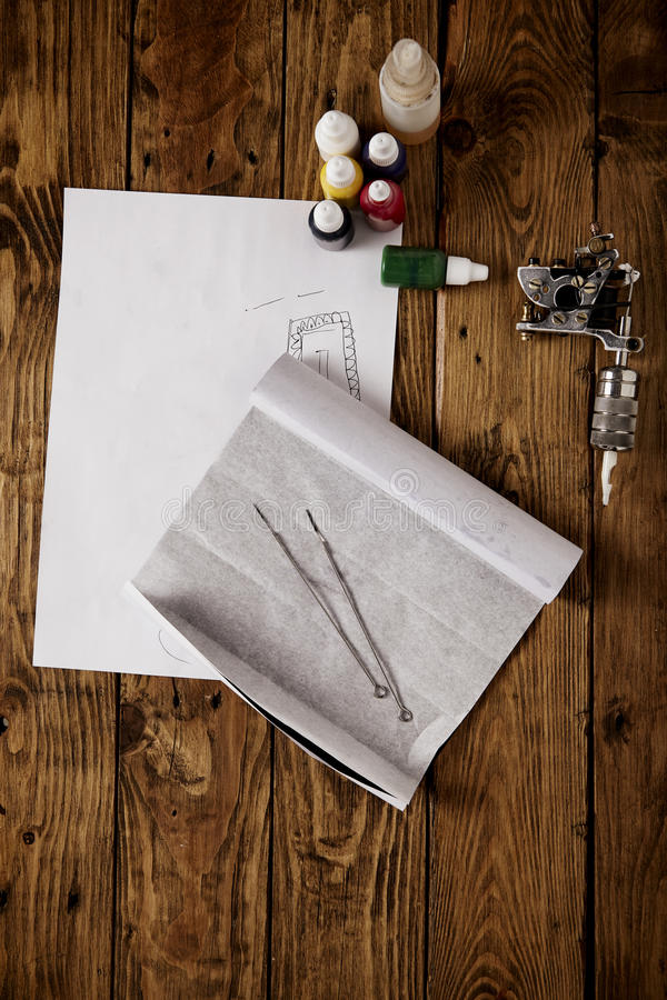 Sketch and tattoo tools. On wooden table, top view stock photo