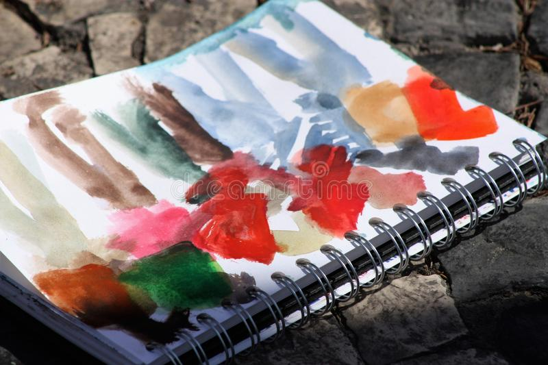 Sketchbook. A sketchbook is a book or pad with blank pages for sketching and is frequently used by artists for drawing or painting as a part of their creative vector illustration