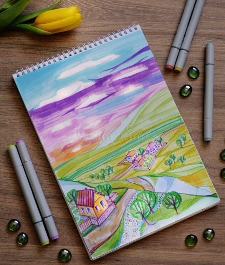 Sketchbook con l'illustrazione disegnata a mano dell'indicatore del paesaggio variopinto della campagna fotografie stock libere da diritti