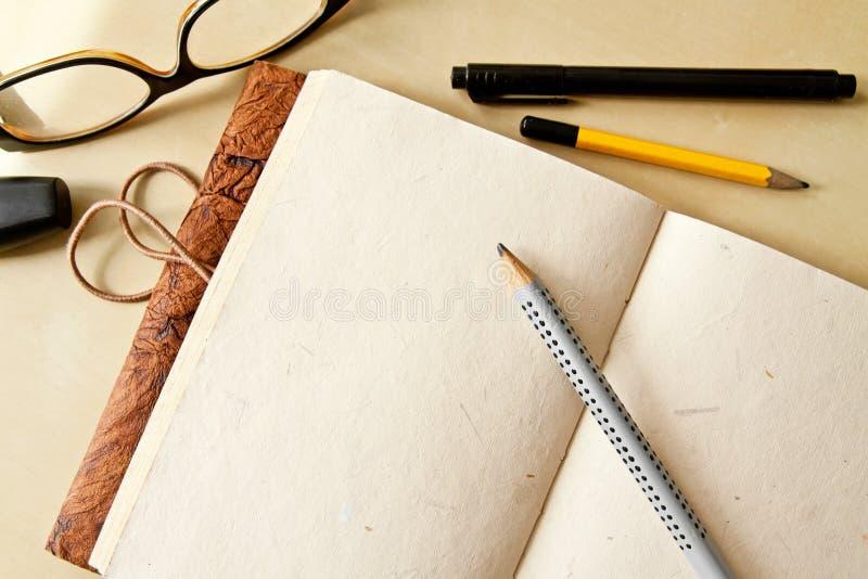 Sketchbookanteckningsbok royaltyfri bild