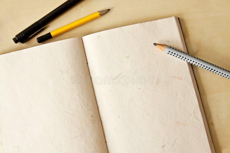 Sketchbookanteckningsbok royaltyfri foto