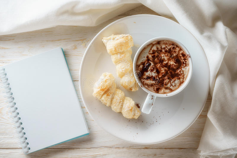 Sketchpad and a cup of hot cocoa. Flat lay stock photos