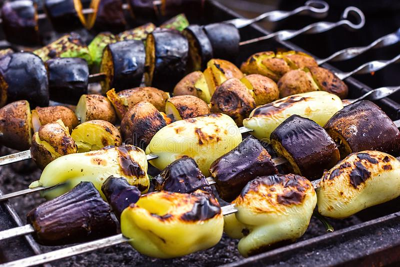 Skewered vegetables green zucchini courgettes cucumber peppers preparing barbecue grill charcoal Grilled roasted fried slices cove. Red beautiful crust royalty free stock photo