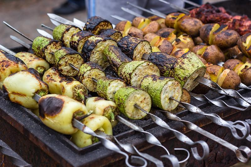 Skewered vegetables green zucchini courgettes cucumber peppers preparing barbecue grill charcoal Grilled roasted fried slices cove. Red beautiful crust stock photography