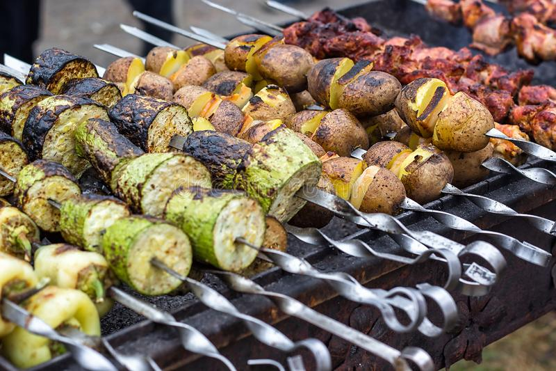 Skewered vegetables green zucchini courgettes cucumber peppers preparing barbecue grill charcoal Grilled roasted fried slices cove. Red beautiful crust royalty free stock image