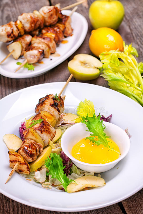 Skewers of chicken fillet with apples royalty free stock photo