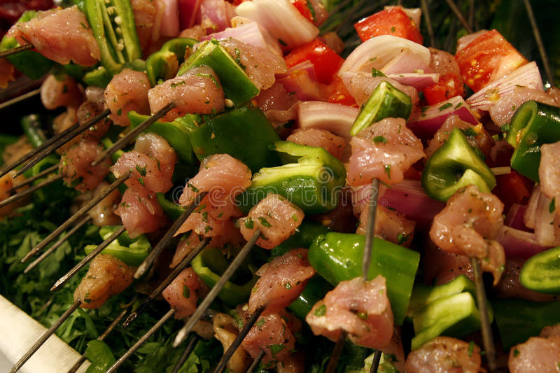 Skewers of fresh shish kebabs waiting to be cooked royalty free stock photography