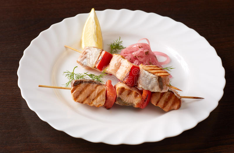 Skewers of grilled fish and vegetables, close-up stock image