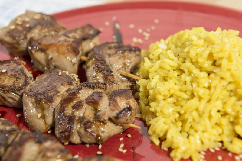Skewers of grilled pork royalty free stock photography