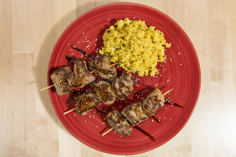 Skewers of grilled pork royalty free stock images