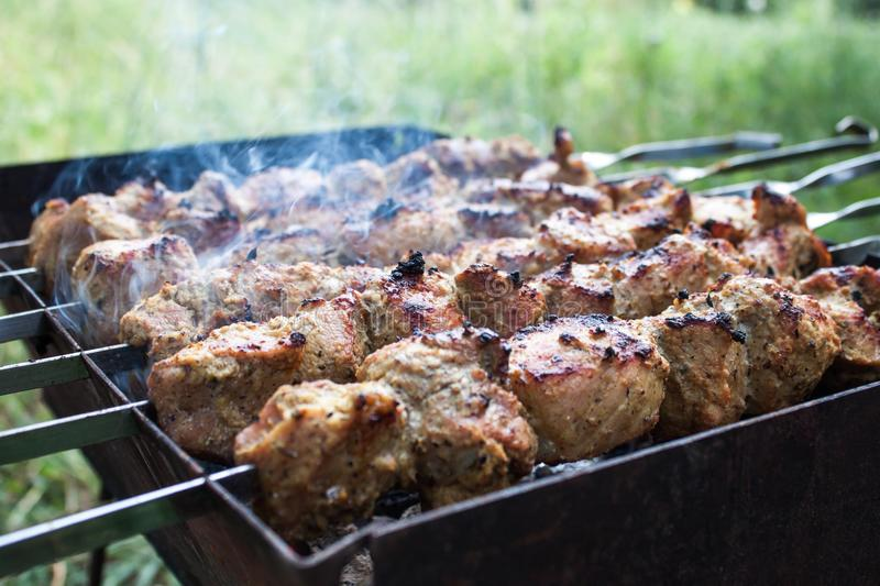 Skewers grilling. On a barbecue stock photography